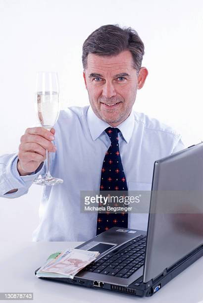 Businessman holding a glass of sparkling wine