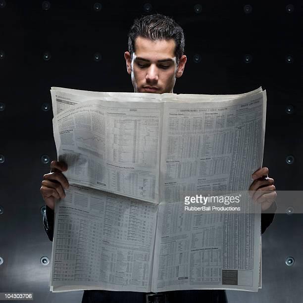 businessman holding a newspaper - man holding paper imagens e fotografias de stock
