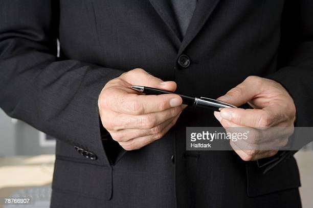 A businessman holding a pen