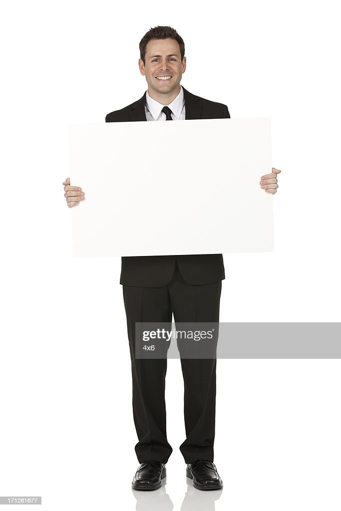 Businessman Holding A Placard High-Res Stock Photo - Getty ...