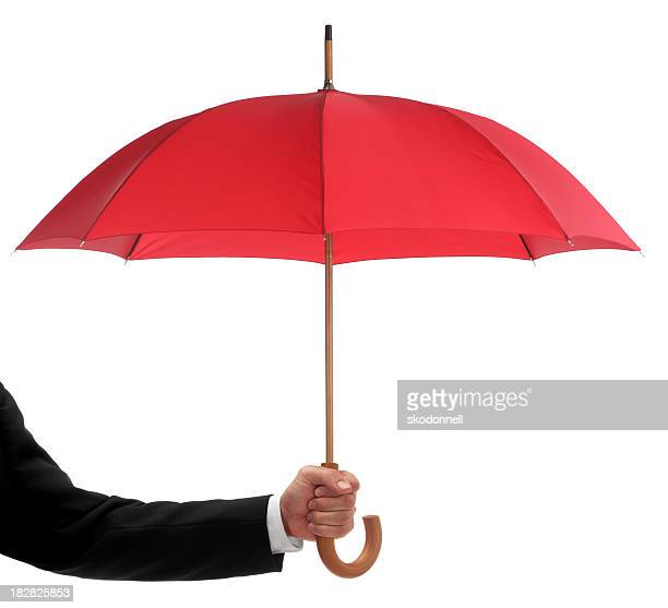 businessman holding a red umbrella - umbrella stock pictures, royalty-free photos & images