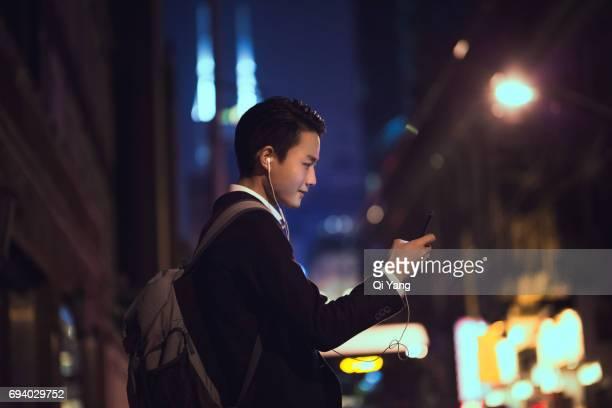 businessman holding a smartphone