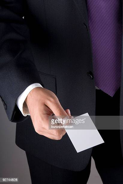 Businessman holding an empty business card