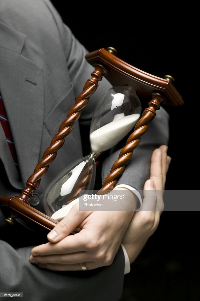 Businessman holding an hourglass : Foto de stock