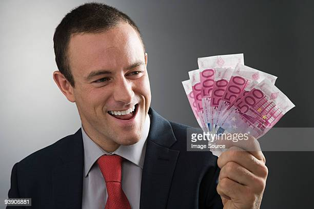 Businessman holding bank notes