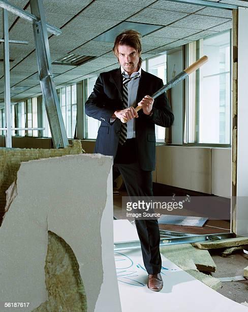 businessman holding baseball bat - bate fotografías e imágenes de stock