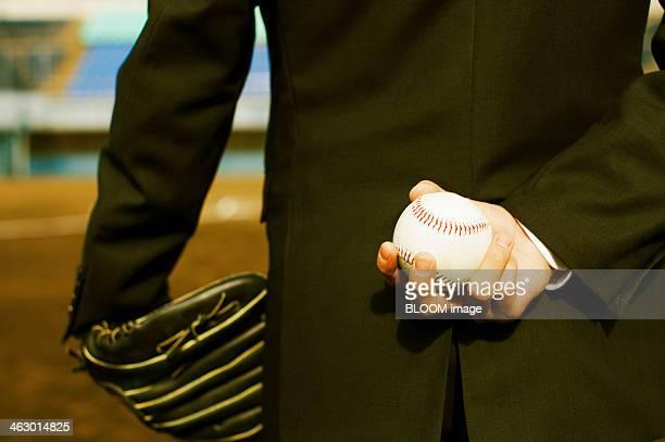 Businessman Holding Baseball