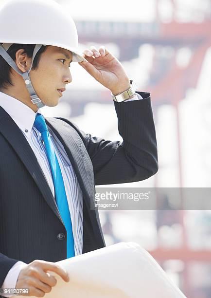 Businessman holding blueprint