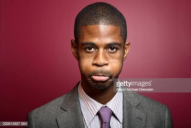 Businessman holding breath, portrait
