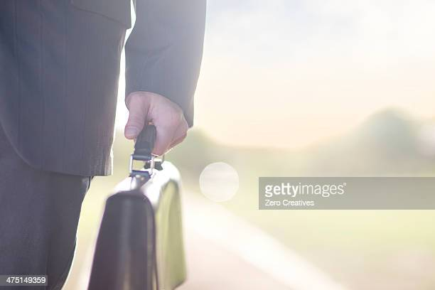 Businessman holding brief case