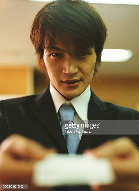 Businessman holding card, close-up