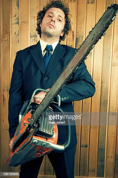 Businessman Holding Chainsaw