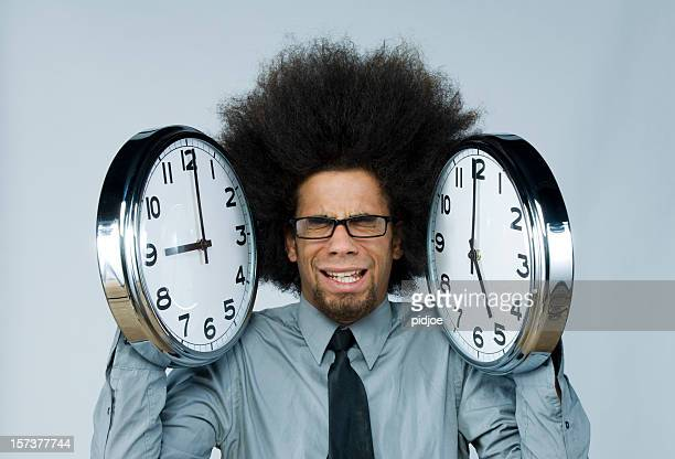 businessman holding clocks indicating office hours