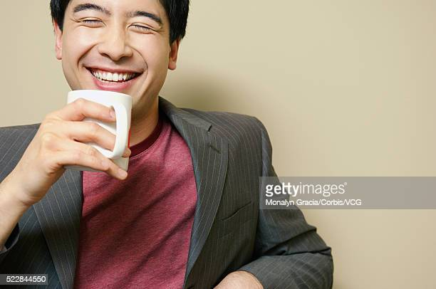 businessman holding coffee cup - lapel stock pictures, royalty-free photos & images