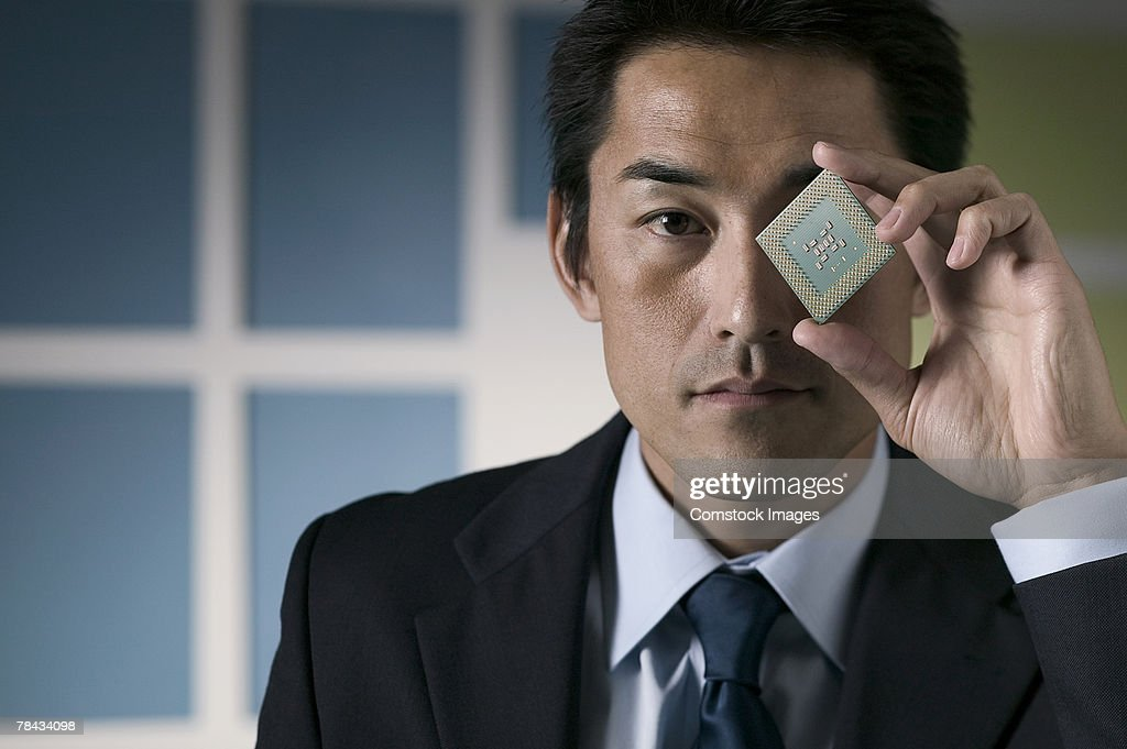 Businessman holding computer chip : Stockfoto