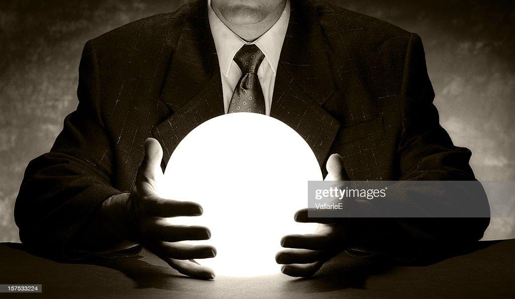 Businessman Holding Crystal Ball : Stock Photo