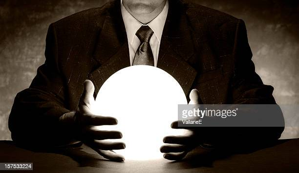 Businessman Holding Crystal Ball
