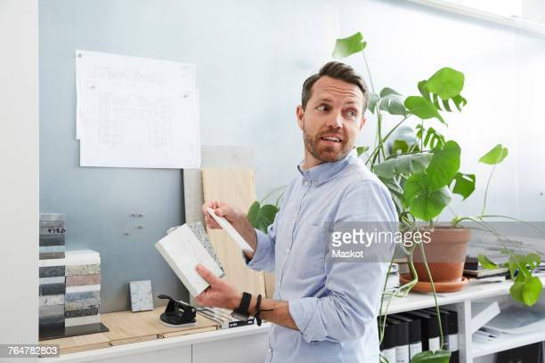 Businessman holding diary working at creative office