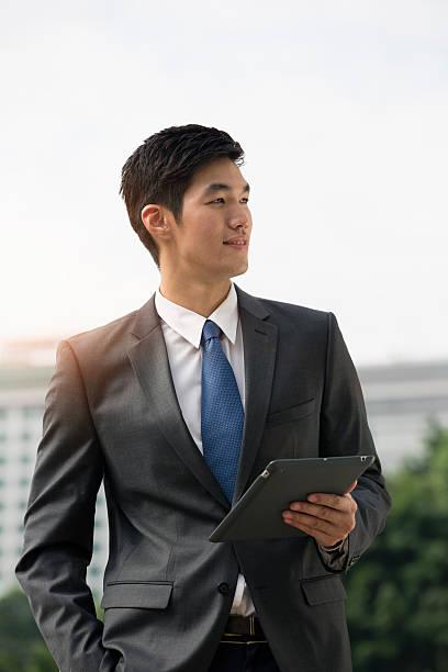 Businessman Holding Digital Tablet Outdoors. Wall Art