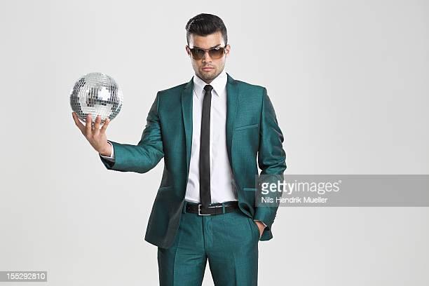 Businessman holding disco ball