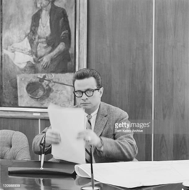 Businessman holding document, portrait
