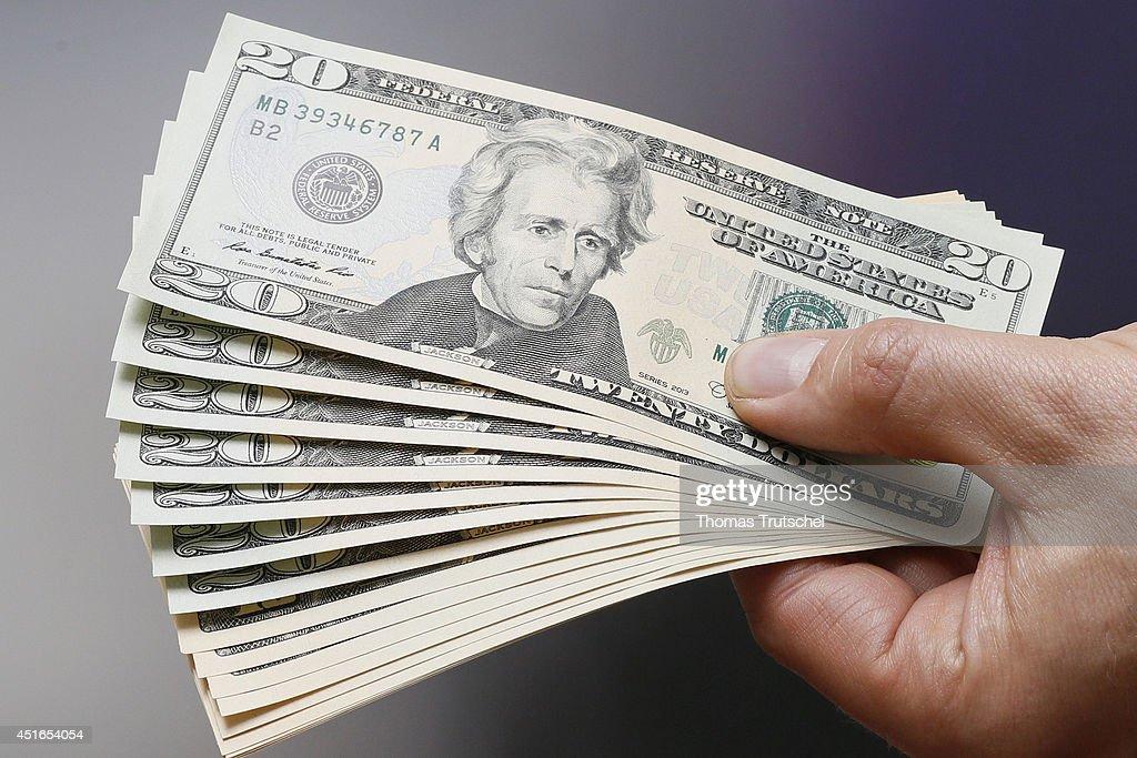 Businessman Holding US Dollars : News Photo