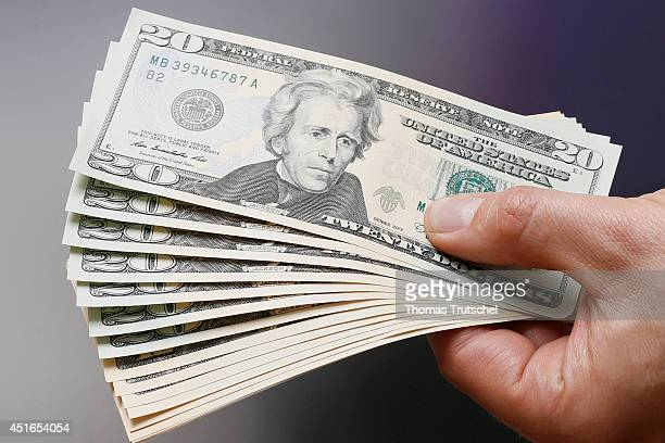 Businessman holding dollar bills in his hands on July 02 in Berlin Germany