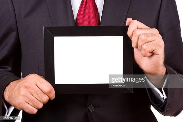 Businessman holding empty frame
