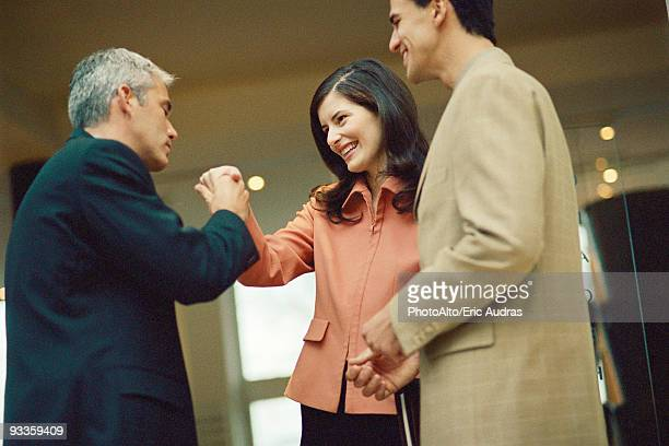 Businessman holding female colleague's hand