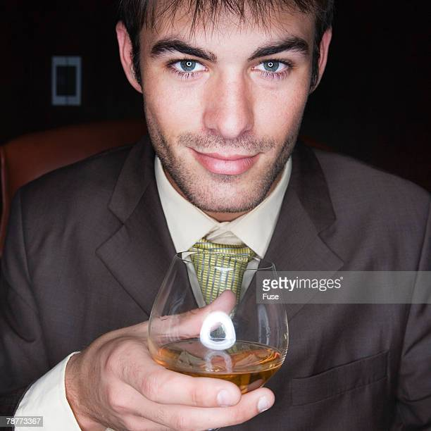 Businessman Holding Glass of Brandy