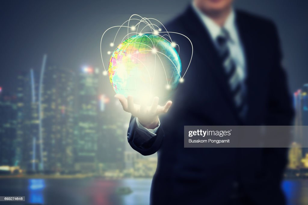 Businessman holding globe network with technology application icons of social network design : Stock Photo