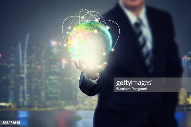 businessman holding globe network with technology application icons of social network design - event icon set stock photos and pictures