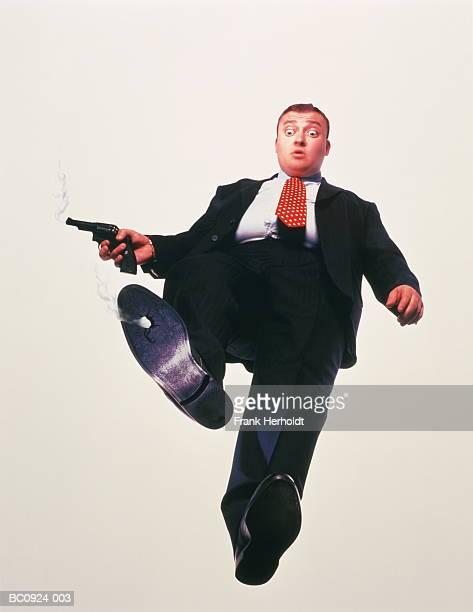 businessman holding gun,bullet hole in shoe,upward view (enhancement) - 真下からの眺め ストックフォトと画像