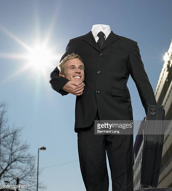 Businessman holding head under arm (Digital Enhancement)