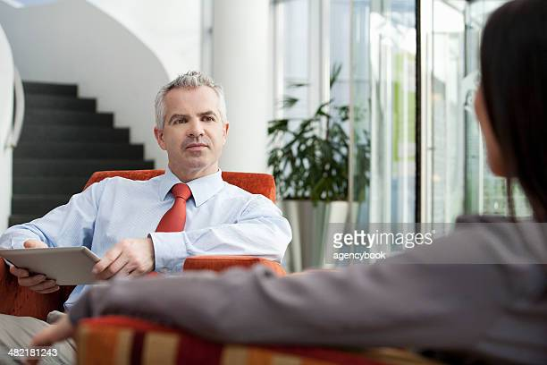 Businessman holding interview in office
