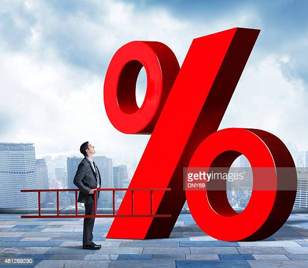 Businessman Holding Ladder Looking Up At Percentage Sign