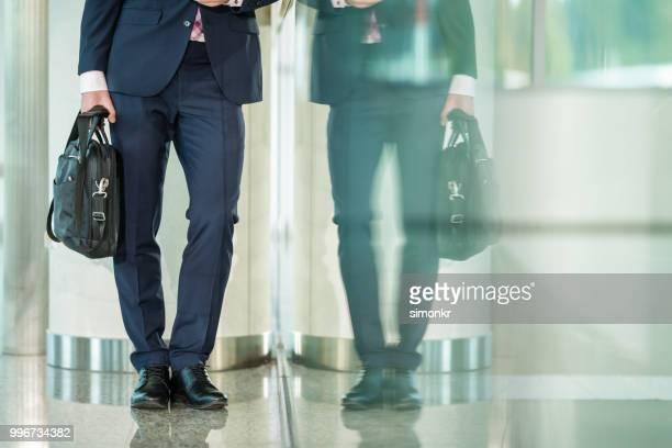 Businessman holding laptop bag