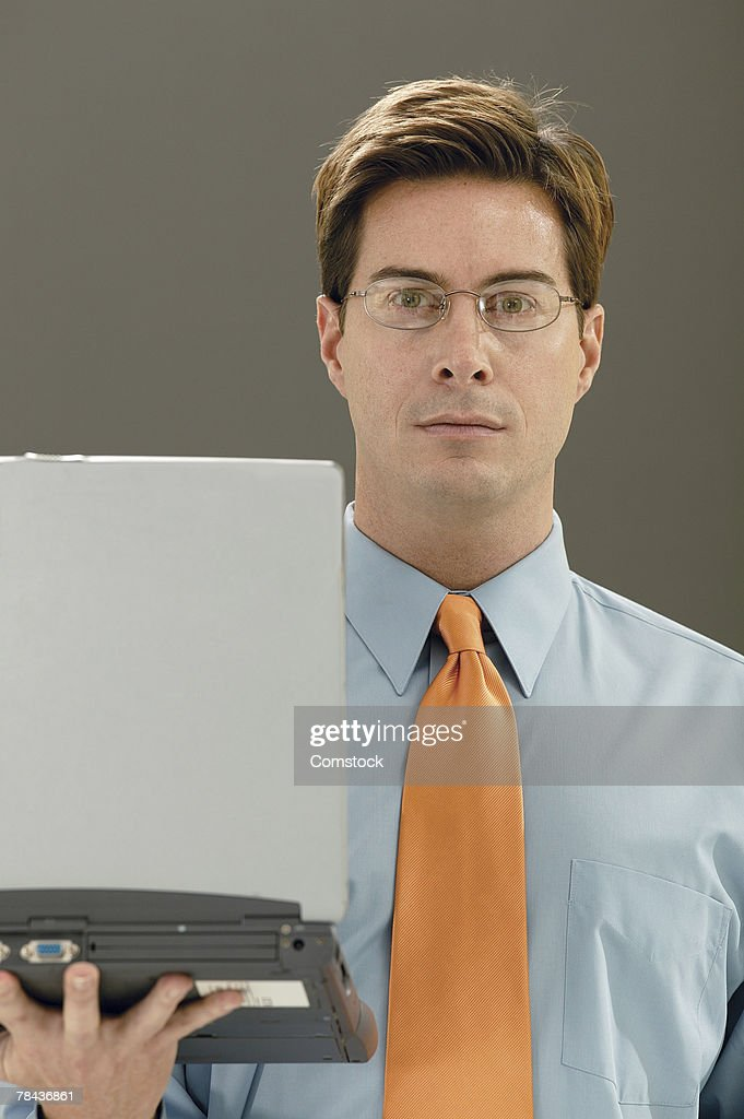 Businessman holding laptop computer : Stockfoto