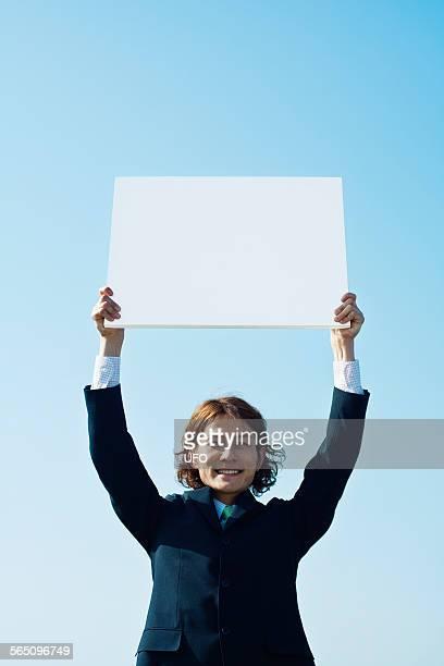 Businessman holding message board