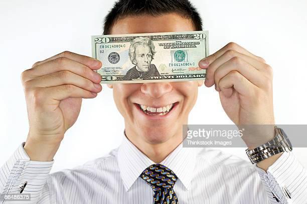 businessman holding money - thinkstock foto e immagini stock