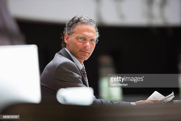 businessman holding newspaper in cafe - 40 49 years stock pictures, royalty-free photos & images