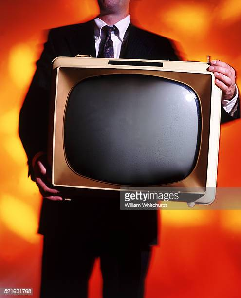 Businessman Holding Old Television