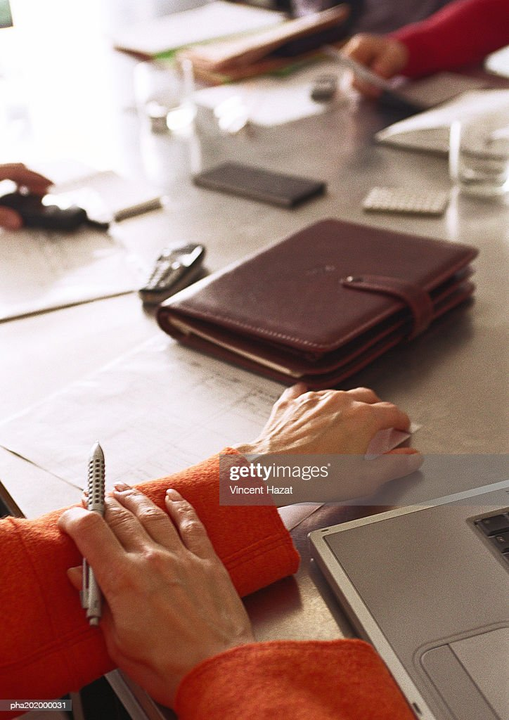 Businessman holding pen, view of table, close up. : Stockfoto