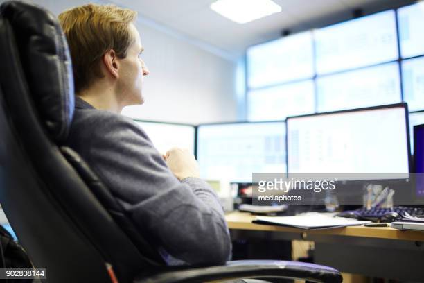Businessman holding research of mining farm