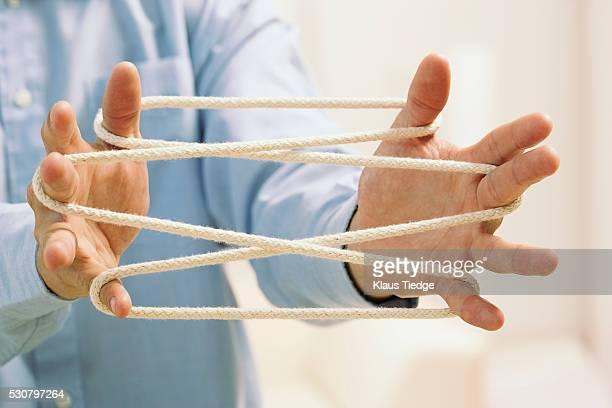Businessman holding rope