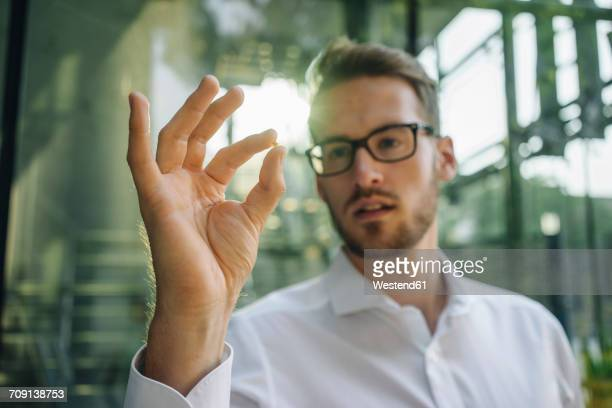 Businessman holding small star in his hand
