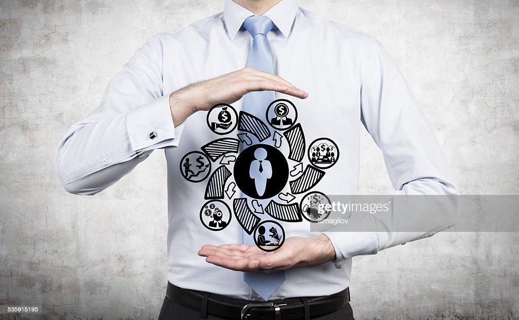 Empresario sostiene símbolo : Foto de stock