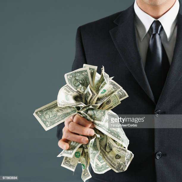 Businessman holding US currency