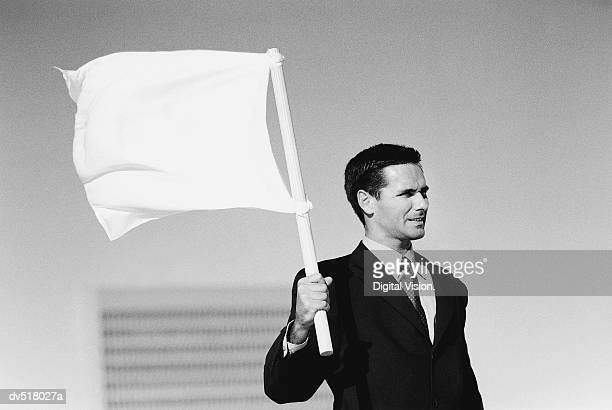 Businessman holding white flag