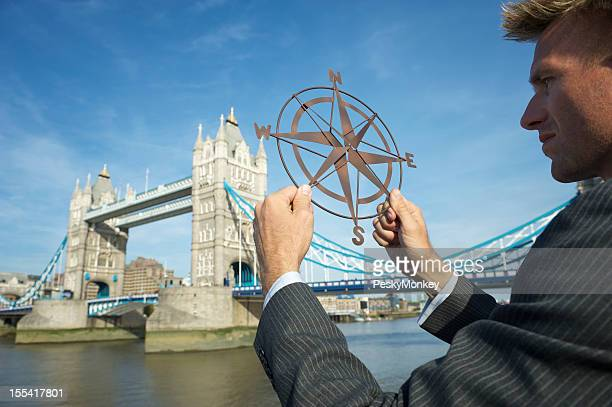 Businessman Holds Compass Above London Skyline